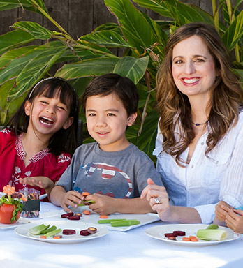 Melissa Halas with kids at table