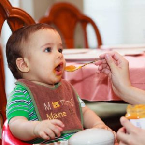 baby eating meal with spices