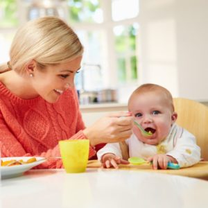mom feeding baby with quinoa for babies - SuperKidsNutrition.com