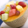 Fresh Fruit in a Canteloupe Melon Bowl garnished with a Melon Sauce