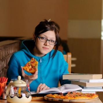 Beautiful college student in pizzeria