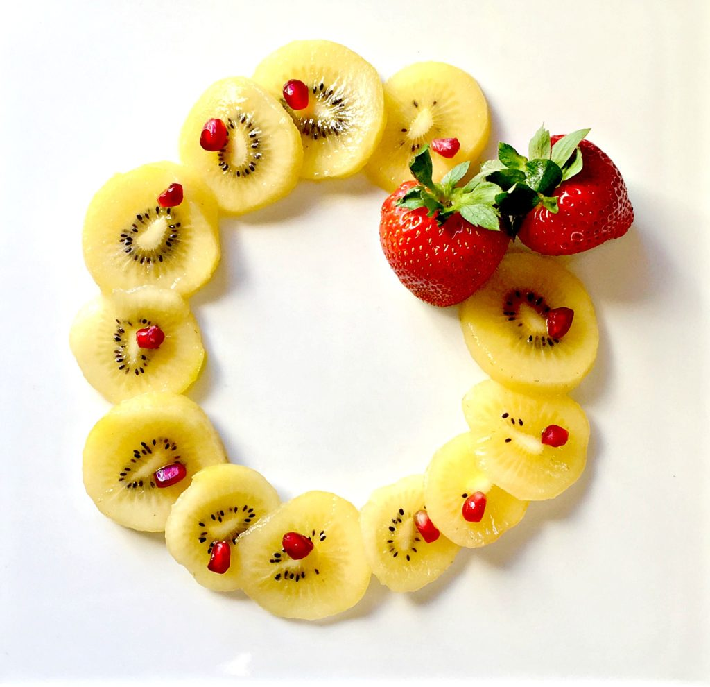 edible kiwi wreath with pomegranate for healthy holidays