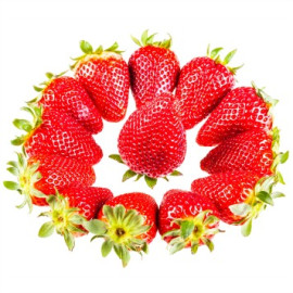 a circle made of ripe red strawberries isolated over a white background