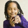 little girl smelling jam HP