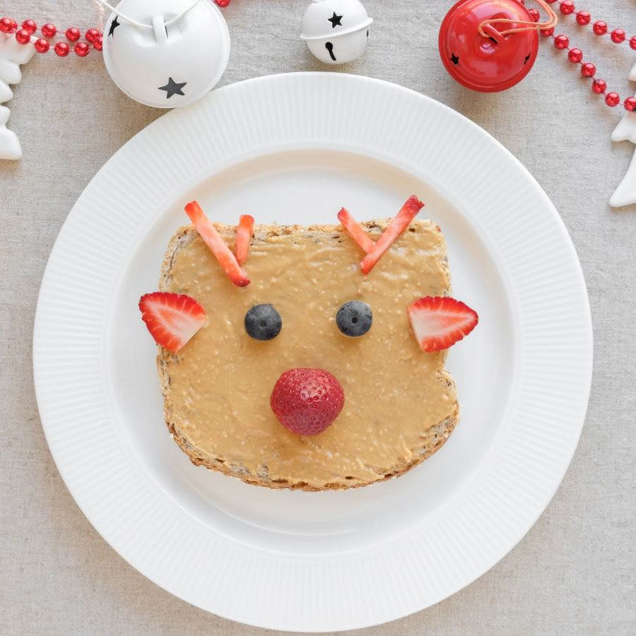 Christmas reindeer on peanut butter toast breakfast, fun food healthy holiday art for kids