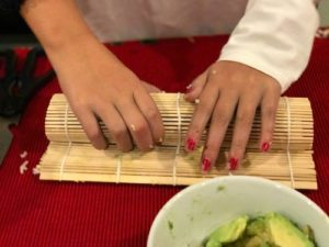 final step of rolling sushi in bamboo