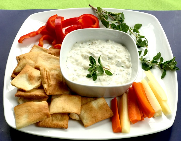 Tasty onion dip with peppers, carrots, and pita chips