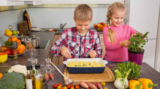 kids cooking in the kitchen with vegetables and herbs, an idea for picky eaters - SuperKidsNutrition.com