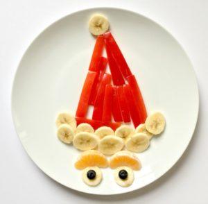 Fun holiday food art santa hat red pepper