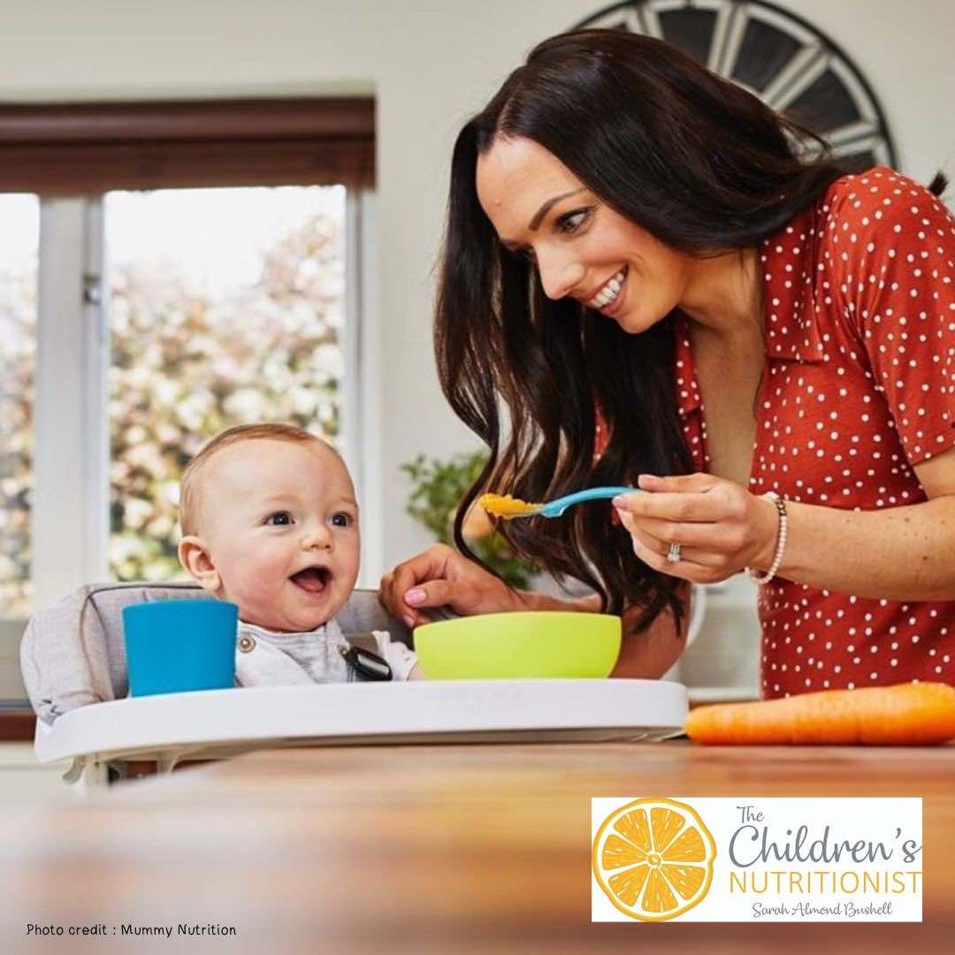 Mom feeding baby - Baby Nutrition & Baby-Led Weaning Course