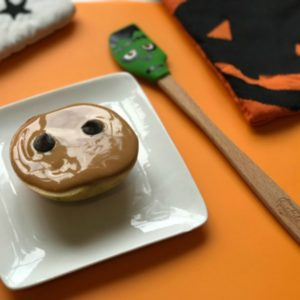apple with peanut butter and eyes for halloween snacks for kids - SuperKidsNutrition.com