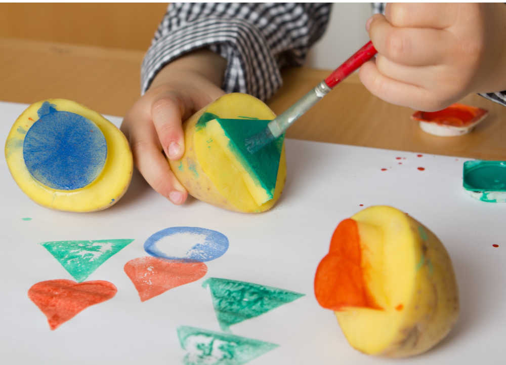 holiday activity homemade wrapping paper with potato stamper