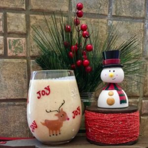 kiwifruit sungold eggnog with a small christmas tree and a snowman for a healthy holiday dessert