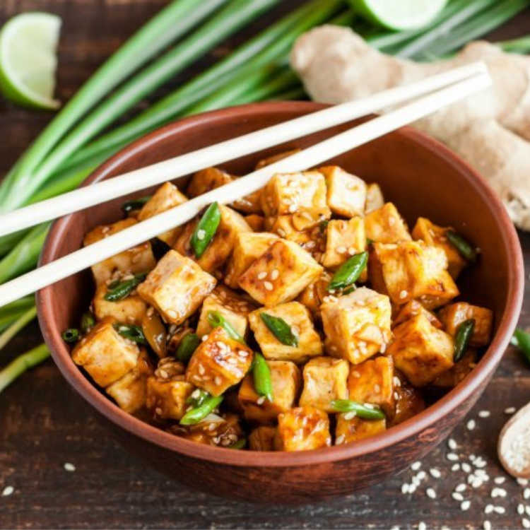 brown bowl with ginger honey tofu for holiday dish