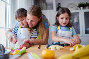 daughter and son cooking with mom fruits for inside article