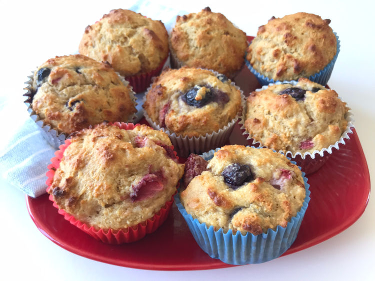 Up close view of red white and blue blueberry muffins