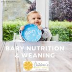 Baby boy with plate for baby nutrition and weaning course by nutritionist