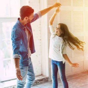 dad and daughter dancing at home