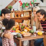 family sitting at table eating high fiber foods to prevent constipation in kids and adults